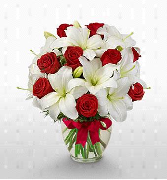 Adanada çiçekçiler hediye çiçek yolla  1 dal kazablanka 11 adet kırmızı gül vazosu